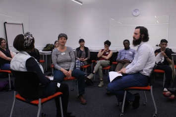 Workshop participants exploring food issues through drama and theatre